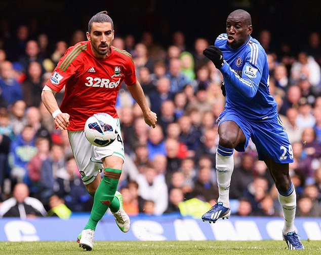 On the charge: Chelsea's Demba Ba (right) and Swansea's Chico chase for a loose ball
