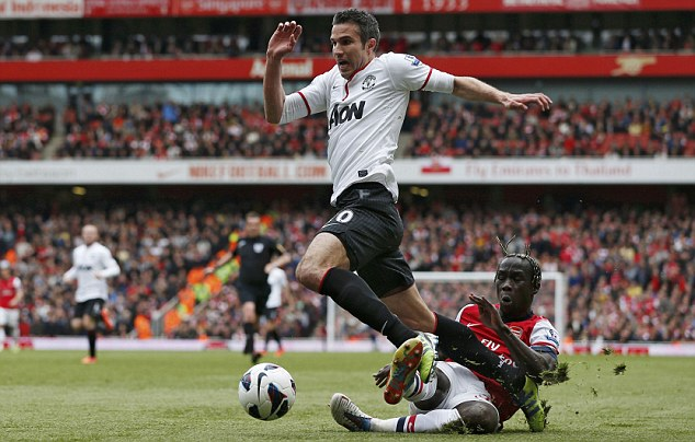 Reckless: Bacary Sagna brought Robin van Persie down inside the box before the Dutchman equalised for United