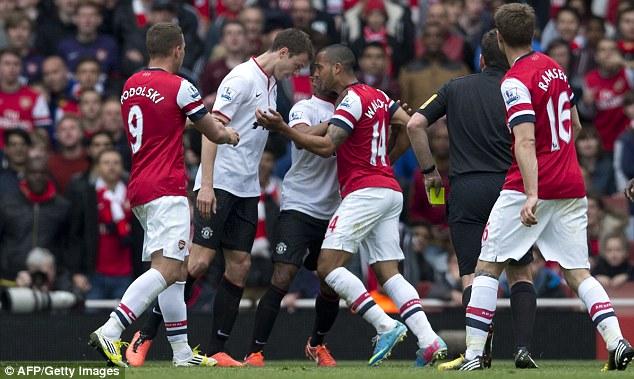 Confrontation: United's Jonny Evans and Arsenal's Theo Walcott go head-to-head