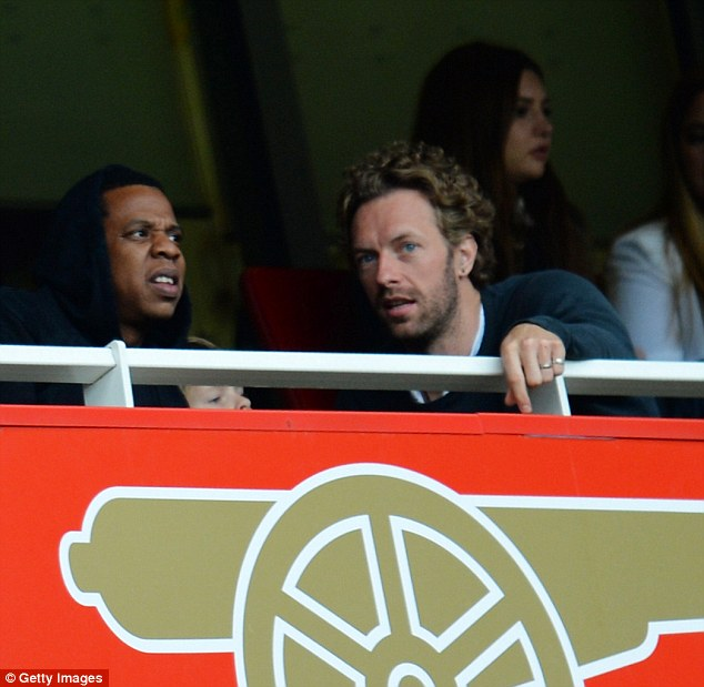 Musical touch: Rapper, Jay-Z (left) and Coldplay's Chris Martin were at the Emirates Stadium