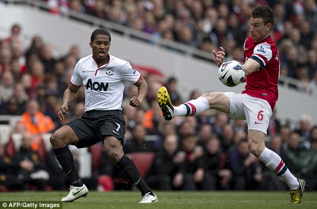 Chased down: Manchester United's Antonio Valencia attempts to cross the ball