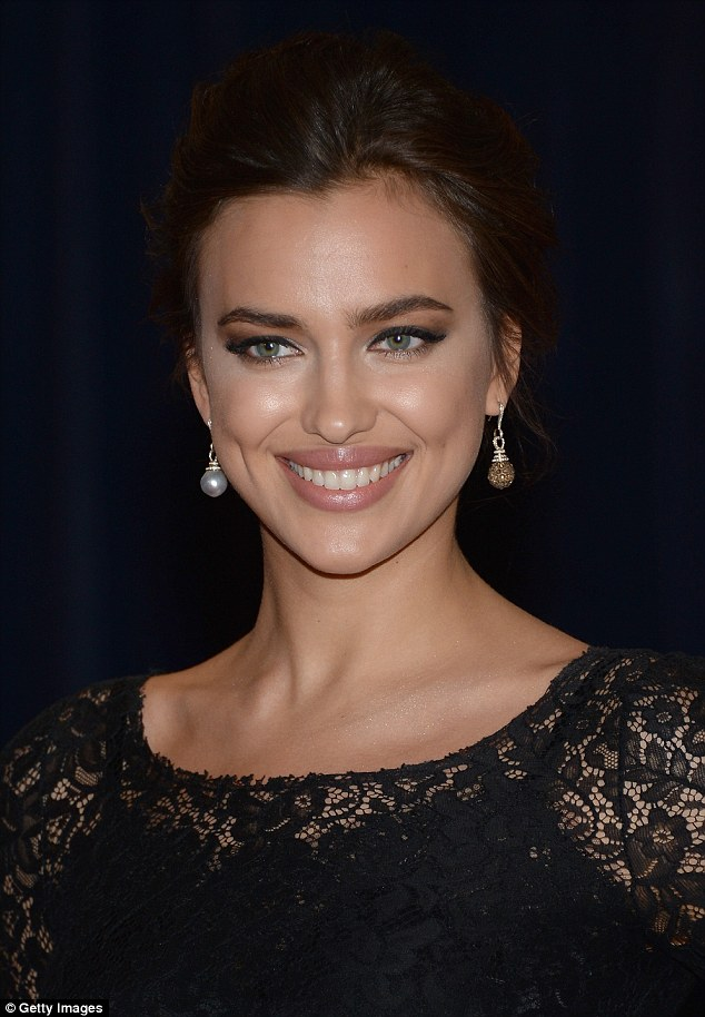 A true beauty: The model wore one pearl earring and one glittering gold earring while she posed on the red carpet