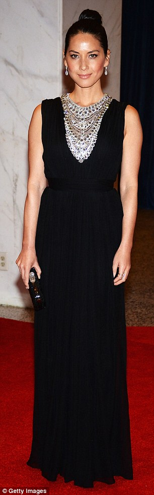 Dark and brooding: Sharon Stone and Olivia Munn opted for black frocks and high updos