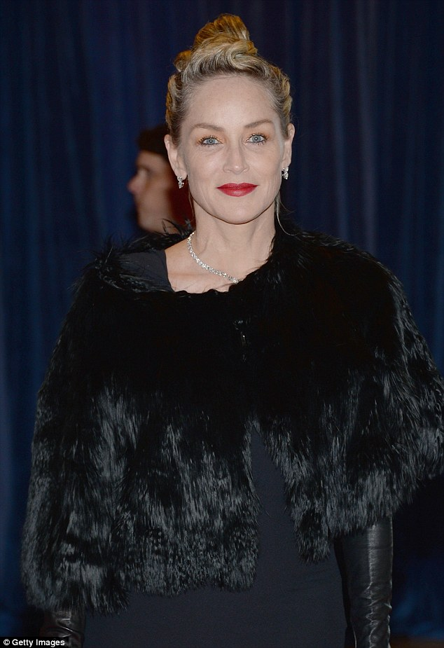 Drama all-around: Sharon wore crimson red lipstick and accessorised with dainty diamond earrings and a diamond necklace