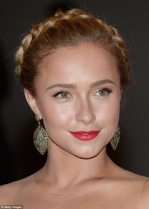 Golden girl: The 23-year-old wore her blonde hair in braid atop her head and added a pop of colour with deep red lipstick