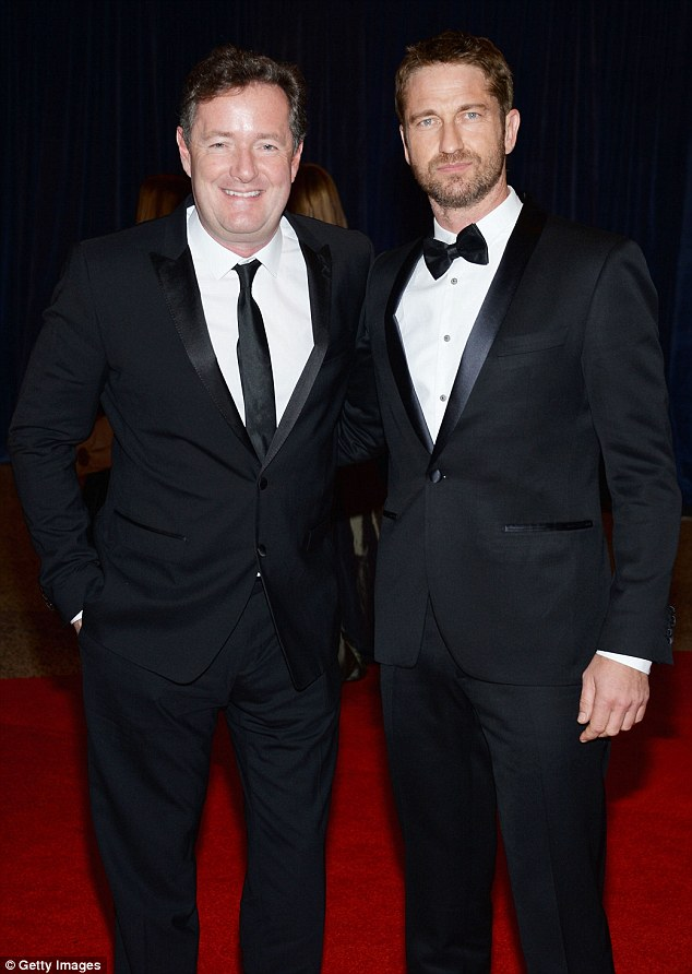 Dapper lads: Piers Morgan and Gerard Butler posed together on the red carpet