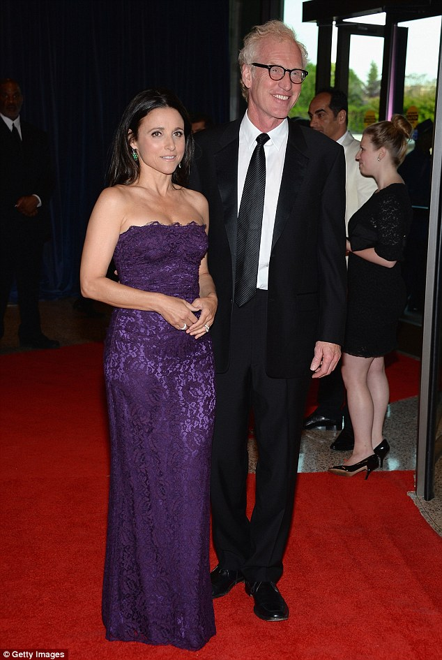 Mingling: Julie Louis-Dreyfuss stood with Saturday Night Live alum Brad Hall at the event
