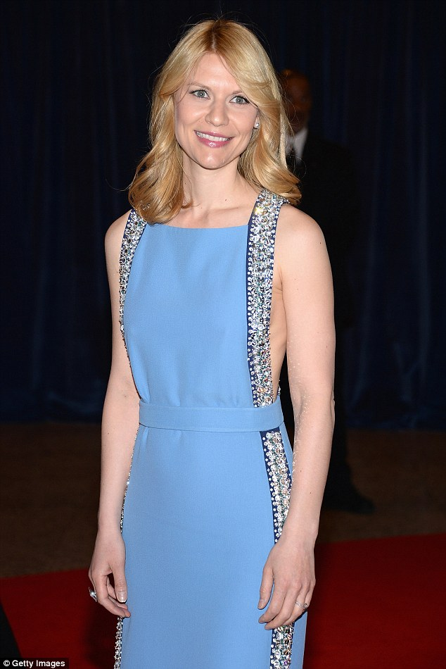 Fit and toned: The 34-year-old showed off her toned arms in the sleeveless frock, which featured cutouts under the arms