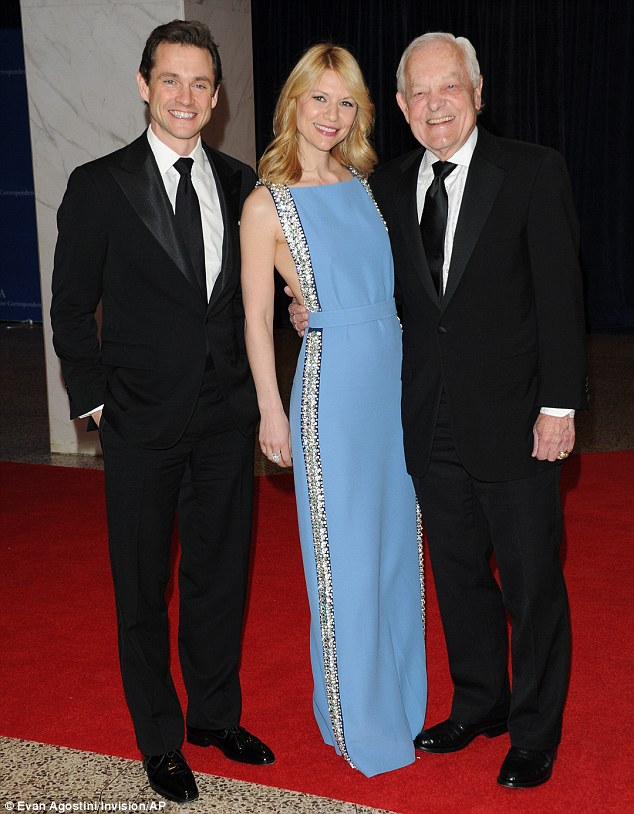 Spot the beauty: Claire posed with her husband Hugh Dancy (left) and journalist Bob Schieffer