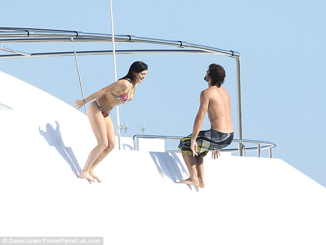 One, two, three: Kylie grinned away as her brother prepared to do a backflip into the ocean