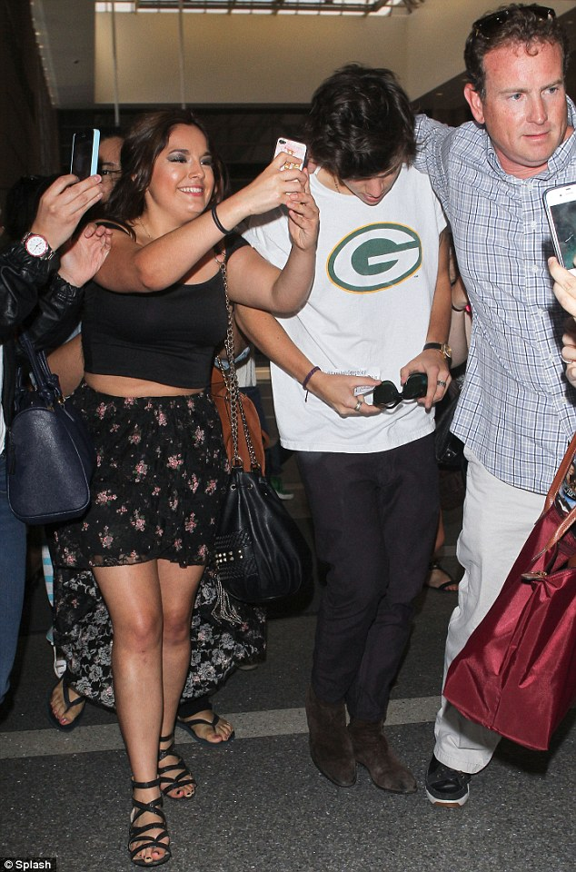 Please, Harry! One young fan seemed keen to get her photo taken with the One Direction singer