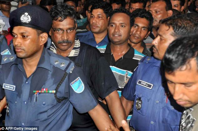 Two arrested owners of the garment factory that collapsed outside the capital, are today escorted to an appearance at the court in Dhaka