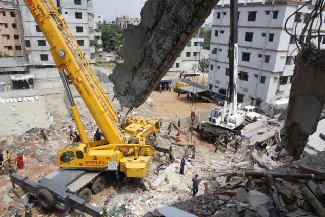 Soldiers clear away the crumbled concrete of the Rana Plaza building. Fears are mounting that the death toll could rise far beyond the latest figure of 363