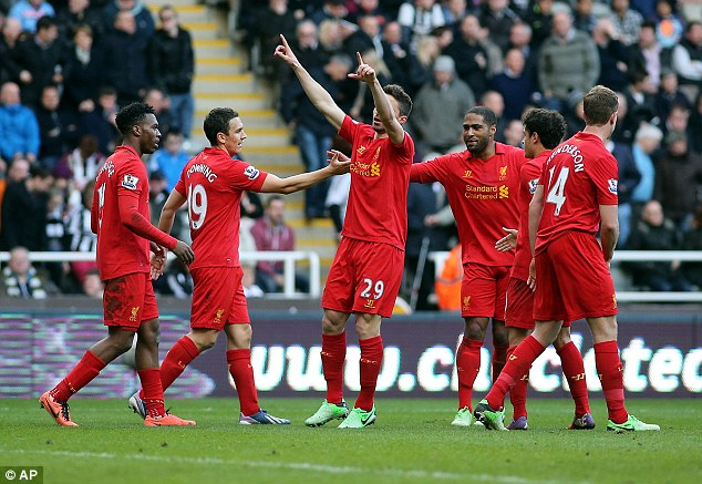 Too easy: Liverpool celebrate Fabio Borini's goal, the fifth of their six at St James' Park