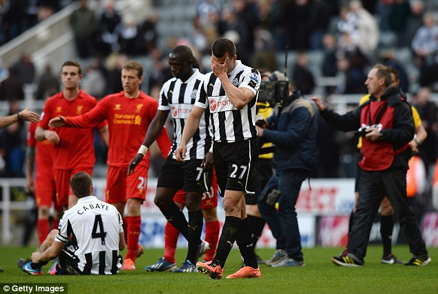Humiliation: Steven Taylor and his Newcastle team-mates trudge off after Saturday's 6-0 defeat by Liverpool, the club's heaviest home defeat since 1925
