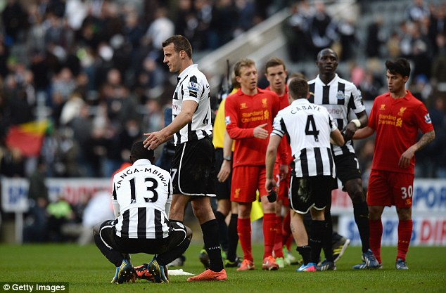 Consolation: Taylor speaks to Mapou Yanga-Mbiwa after the 6-0 defeat, a result that leaves Newcastle in the relegation mire