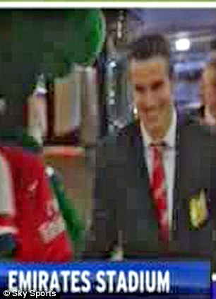 Good to see you: Robin Van Persie shakes hands with Arsenal mascot Gunnersaurus