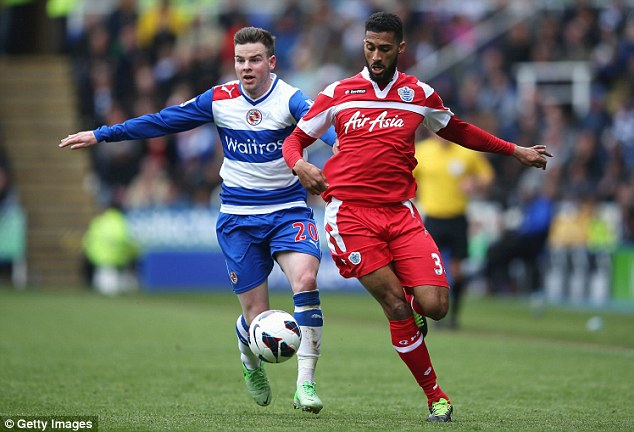 Positive: Armand Traore surges forward from the left back position as Danny Guthrie (left) trails