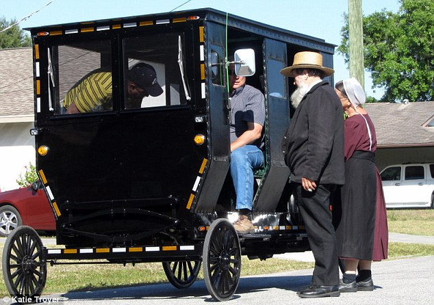 The owner of this solar-powered buggy said he wasn't sure if the it would catch on among the Amish. But he said he's getting good business - and even a few 'thumbs-ups' from Amish women he passes on the streets