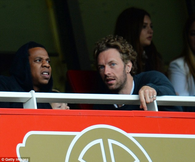 Music makers: Jay-Z (left) and Chris Martin watch Arsenal's draw with Manchester United