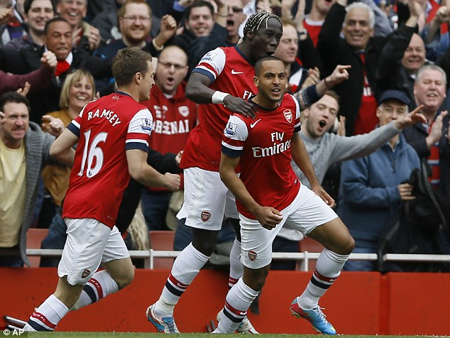 Thanks Theo: Walcott (right) got Arsenal off to a fine start by scoring early on
