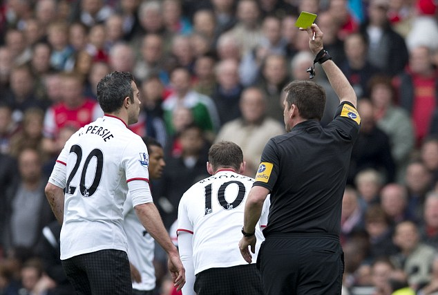 Trigger happy? Phil Dowd issued five yellow cards to Manchester United