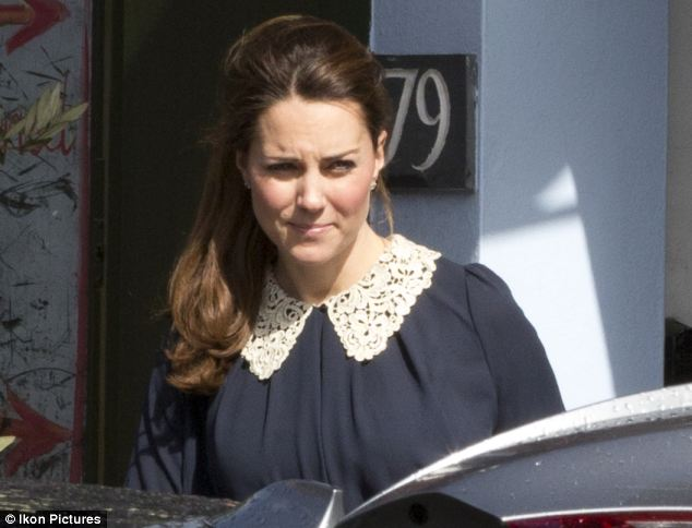 Kate wore a loose blue maternity top with a pretty lace collar for the outing