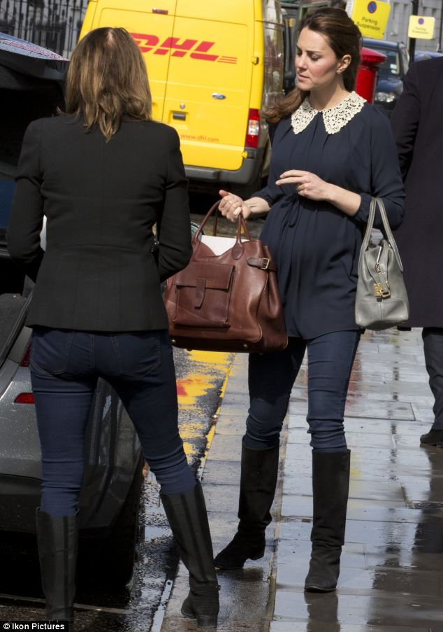 The Duchess carried two handbags while Carole took care of carrying the large white wicker Moses basket