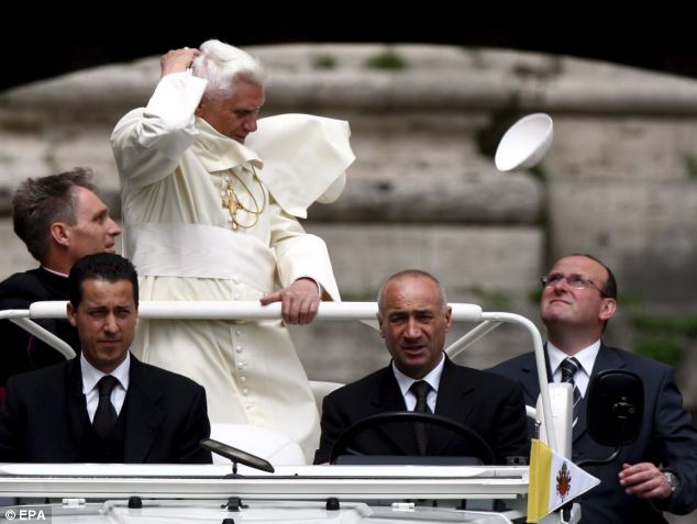 Pope Benedict XVI was surprised by a gust of wind as he crossed Bells Arch in the Vatican City for the general Audience at St. Peter's Square in May 2006