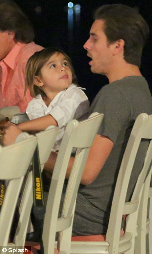 Reunited: Mason and father Scott Disick were enjoying some father and son time after Scott jetted in from London