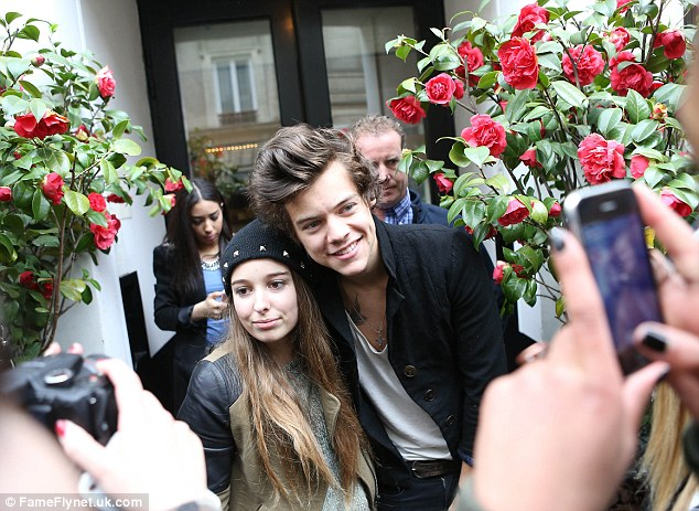 Dedicated fans: Harry grinned as his biggest supporters turned out to met him, posing with as many as possible
