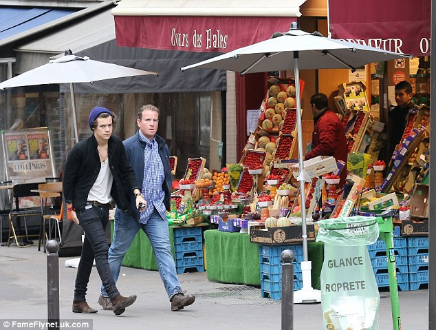 Parisian life: Harry seemed quite content to be wandering around the city and soaking in the sights