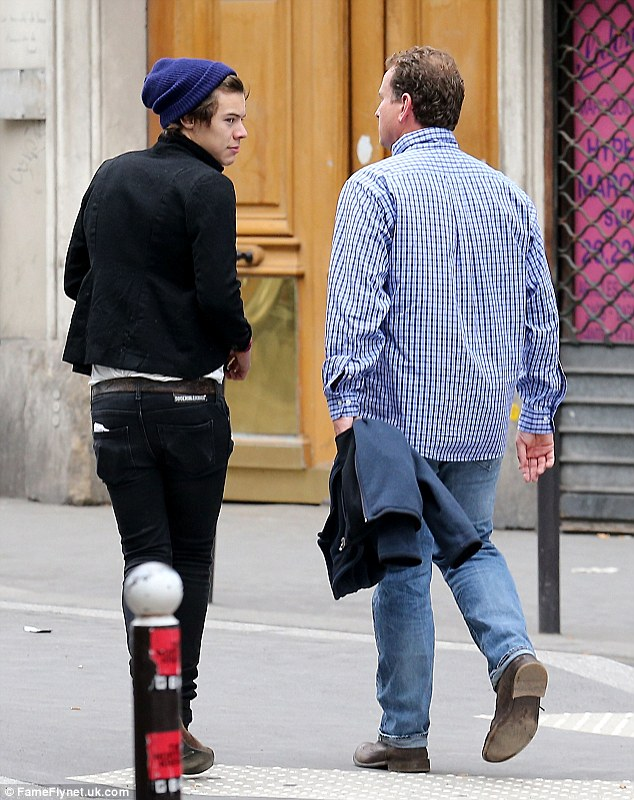 On the look out: Harry looked behind to check that he wasn't being followed by his hoards of female admirers