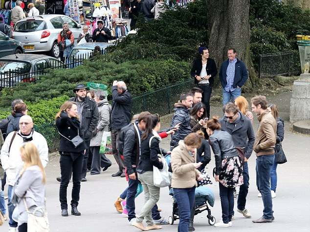 Where's Harry? At times the star seemed to blend in to the crowd but when he was spotted he was mobbed by fans