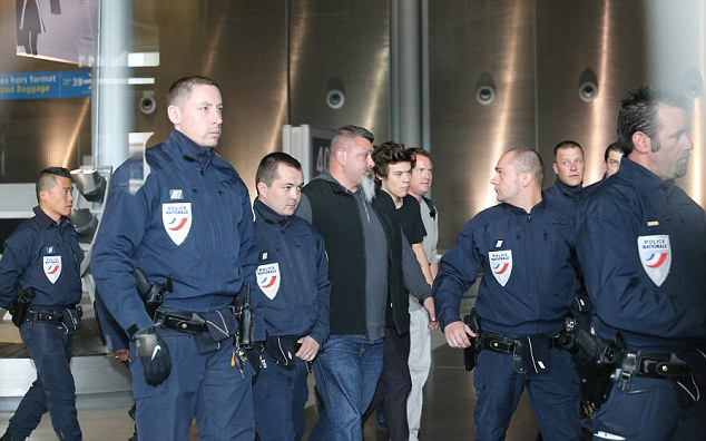 Precious cargo: One Direction heartthrob gets a presidential escort as he arrives at Roissy-Charles de Gaulle airport in Paris