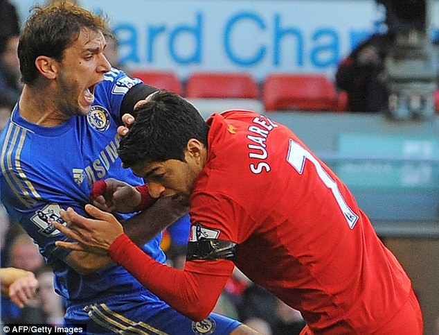 Unexplainable: Luis Suarez picked up a 10-game ban for an offence that cost Jermain Defoe just a yellow card