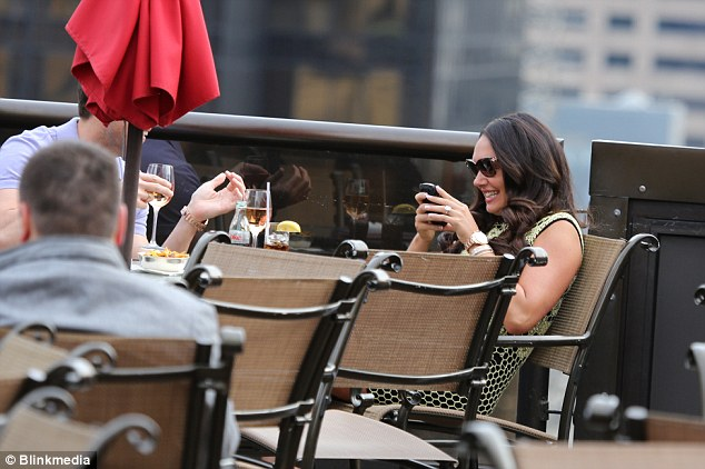 Funny: Tamara giggled away as she looked at something on Scott's phone as they enjoyed a glass of wine