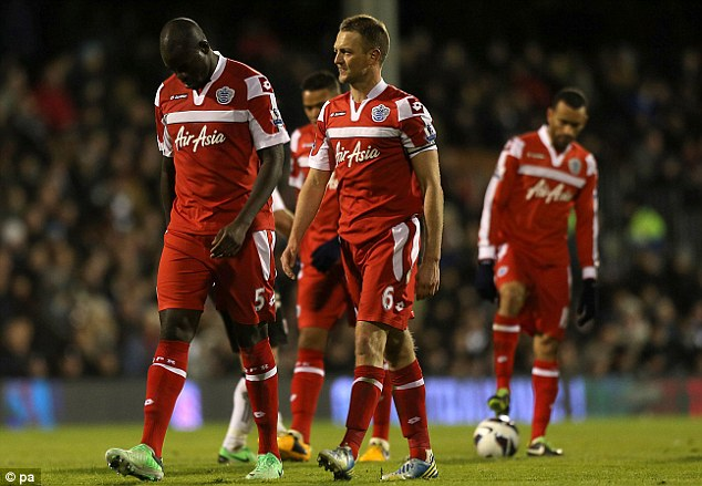 Costly mistake: Chris Samba (left) has been an expensive disappointment at QPR