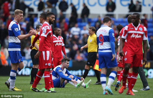 Down and out: QPR, along with Reading, bowed out of the Premier League with a whimper