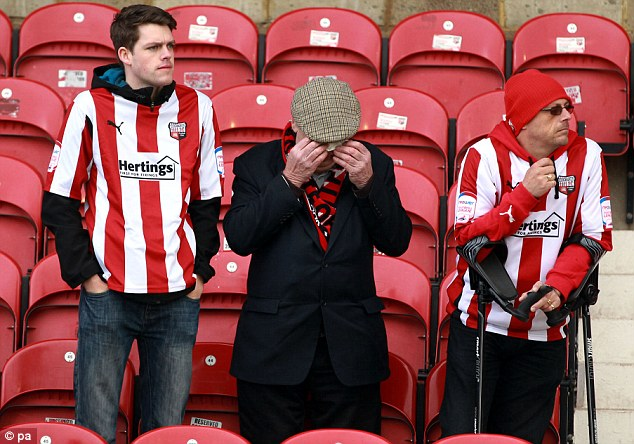Brentford fans look dejected after the npower League One match at Griffin Park, Brentford