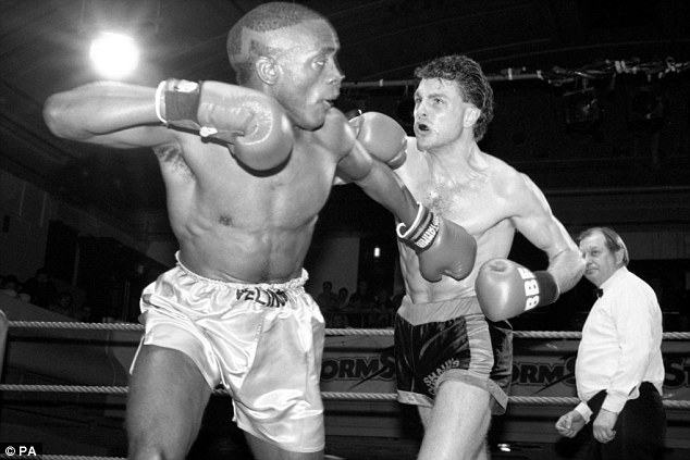 Former boxer: Shaun Cummins (right) on the attack against Tony Velinor (left) 23 years ago in January 1990