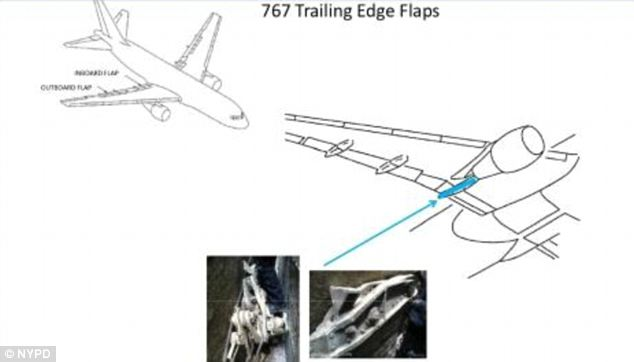 Pivotal piece: The machinery was originally thought to be part of the engine but it is actually a portion of the 767 Trailing Edge Flaps from one of the two planes that slammed into the World Trade Center