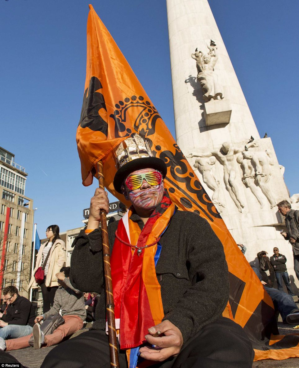 A man waits for the coronation at the Dam Square