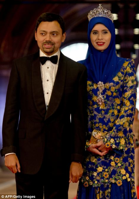 Crown prince Billah and Princess Sarah of Brunei arrive for the dinner at the Rijksmuseum in Amsterdam hosted by Queen Beatrix of the Netherlands on the eve of her abdication