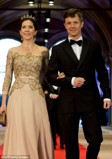 Denmark's Crown Prince Frederik, right, and Crown Princess Mary  attend a dinner at the National Museum (Rijksmuseum) in Amsterdam hosted by Queen Beatrix of the Netherlands on the eve of her abdication