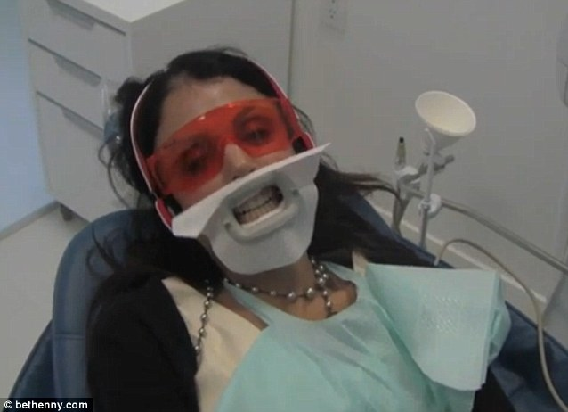 Decked out: The reality star wore a mouth guard and orange goggles as she sat in the dentist's chair