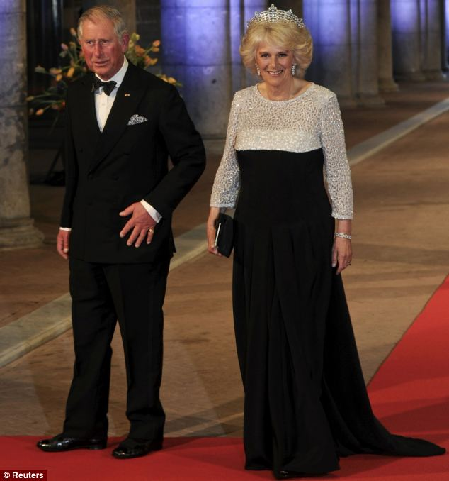 Prince Charles and Camilla, Duchess of Cornwall, made a striking entrance at a gala dinner for the abdication of Queen Beatrix of the Netherlands