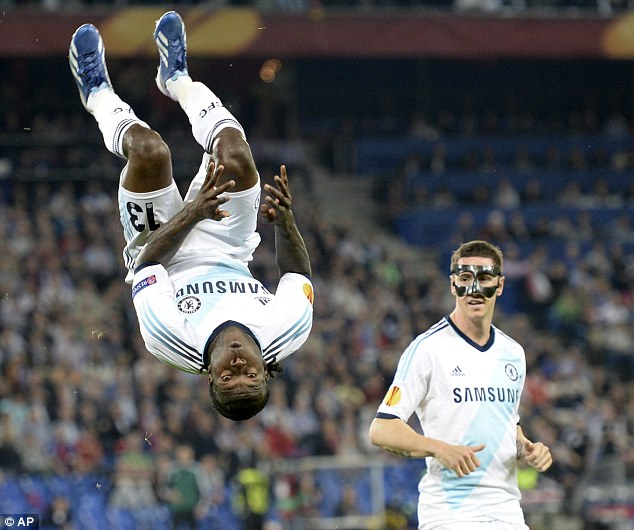 No masking it: Fernando Torres (right) watches as Victor Moses celebrates in exuberant fashion