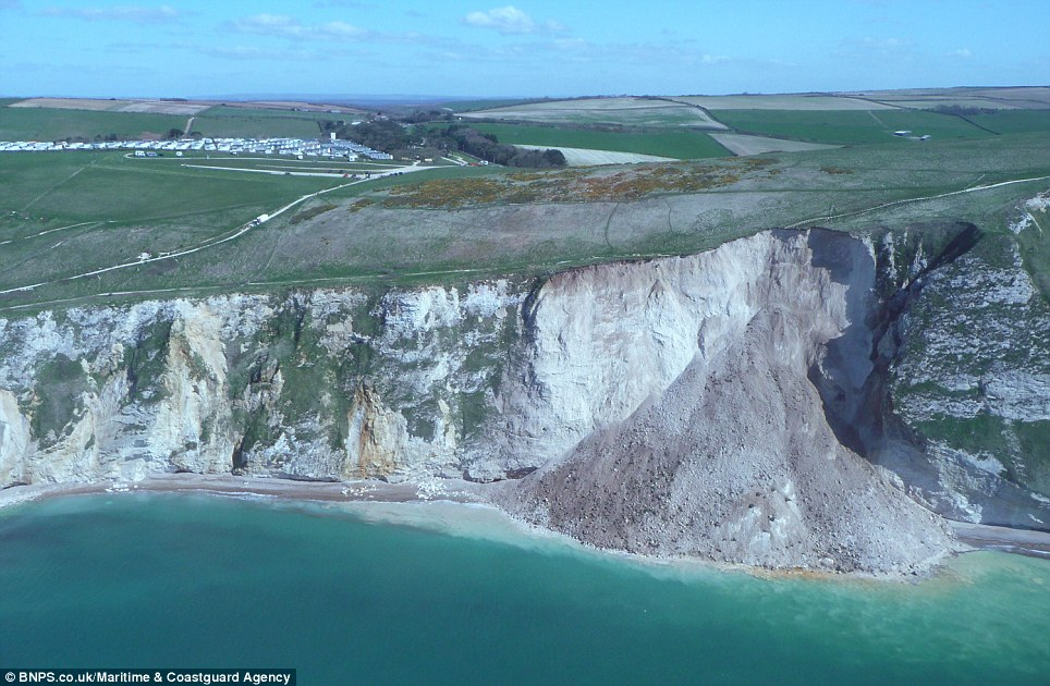 Collapse: A giant pile of rocks now nearly reaches the height of the cliffs after the slump, turning the turquoise water a powdery white colour