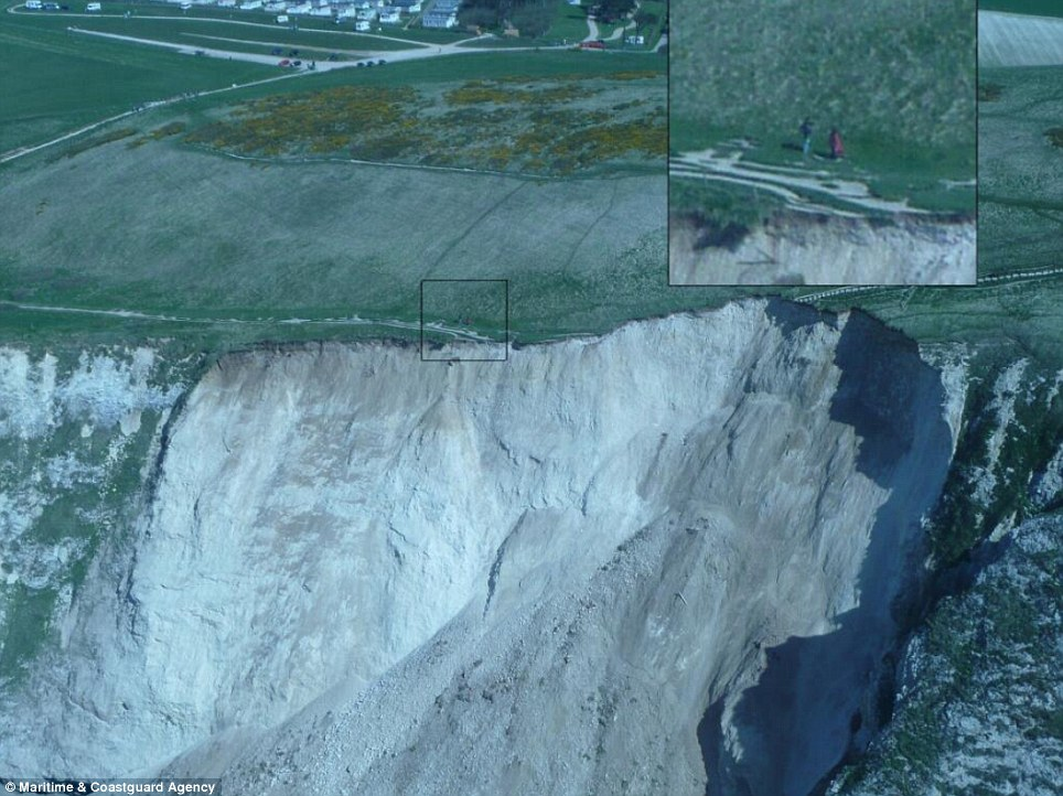 Ignoring warnings: These ramblers decided to walk dangerous close to the edge of the 120ft cliffs near Durdle Door in Dorset just hours after a slippage